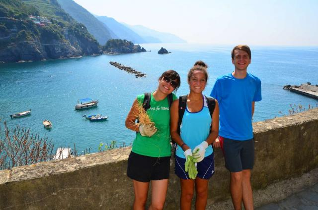 Teens smile along the Cinque Terre while taking in the Mediterranean vistas on their summer program to Italy.