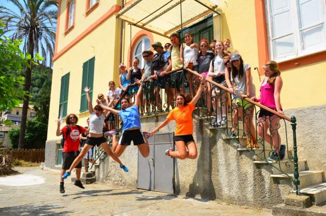 High school travelers jump for joy in Italy on their summer program.