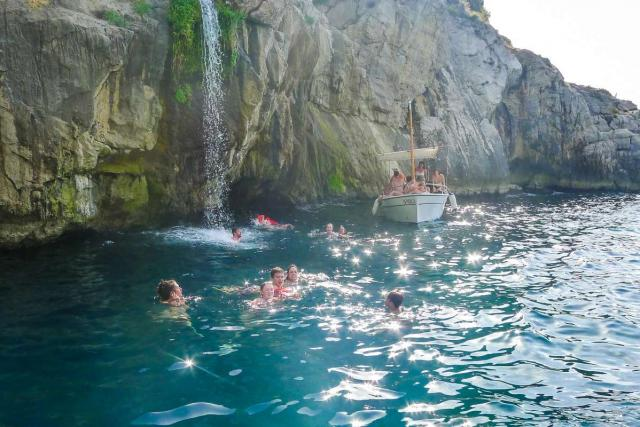 Teens swim in the Mediterranean on their summer program to Italy.
