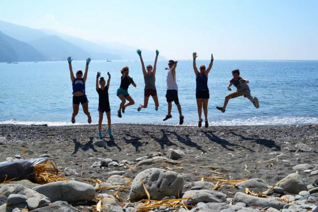 High school students relax on the beach after service work in the Cinque Terre on their summer teen tour to Italy.