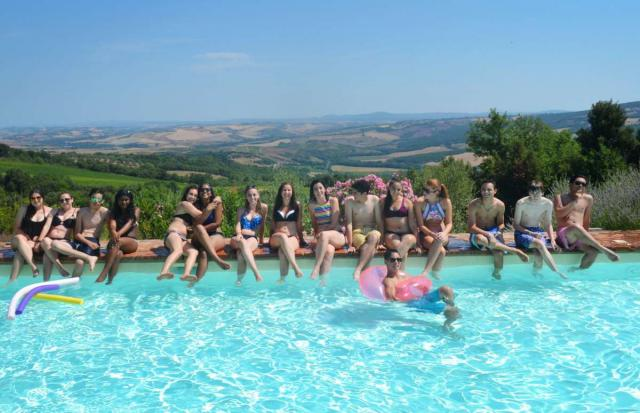 Teens enjoy the summer in Tuscany by the pool on their summer program to Italy