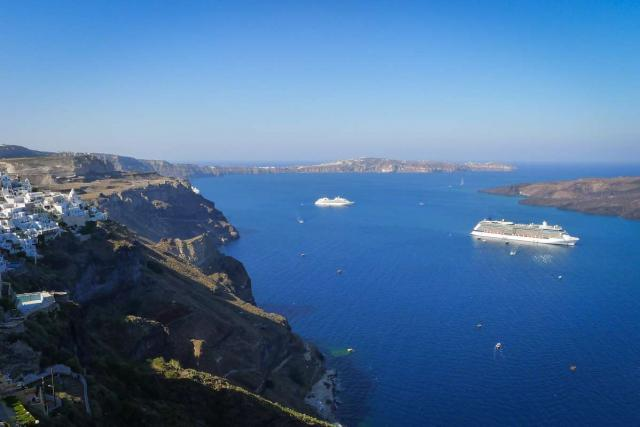 View of islands and cruise ships over Aegean Sea seen by teenage travelers during summer youth travel program in Greece