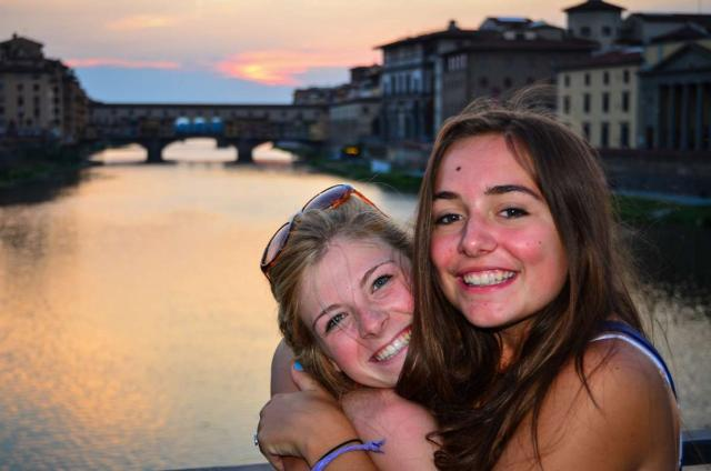 Happy teen travelers at Ponte Vecchio in Florence during summer travel program