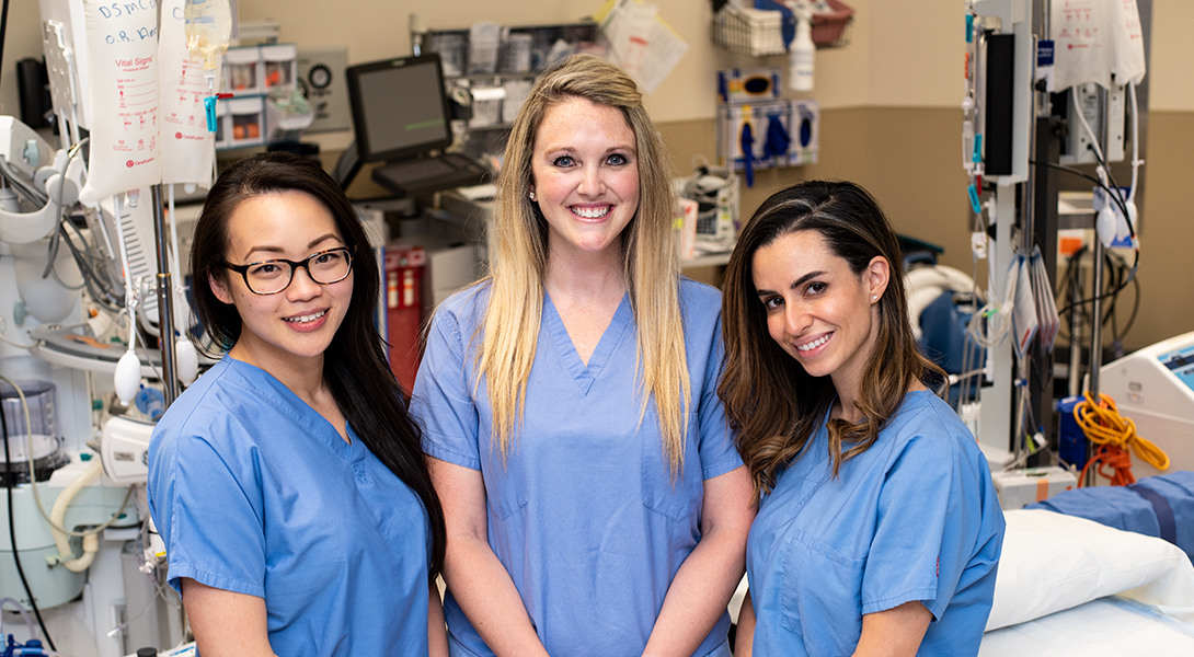 Brittany Bankhead-Kendall, Choyin Yvonne Chung and Pamela Daher, three chief surgical residents, in the operating room