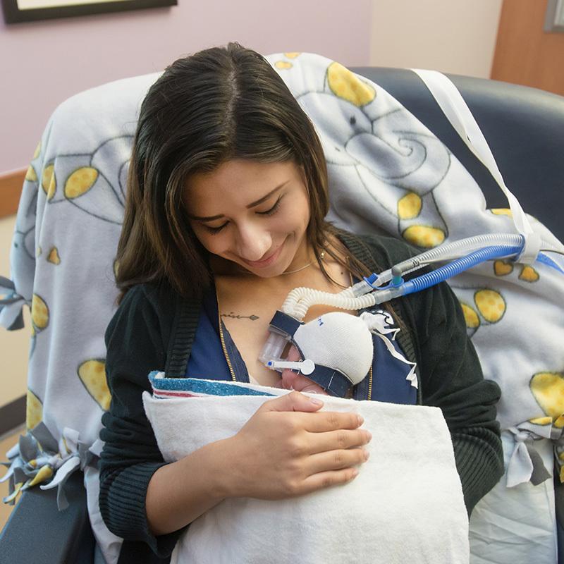 Mariah Montoya holds her baby, Isaiah.