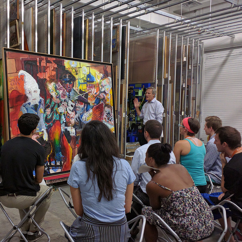 Ray Williams talks with Dell Med students about a painting in the Blanton Museum of Art's Collection.