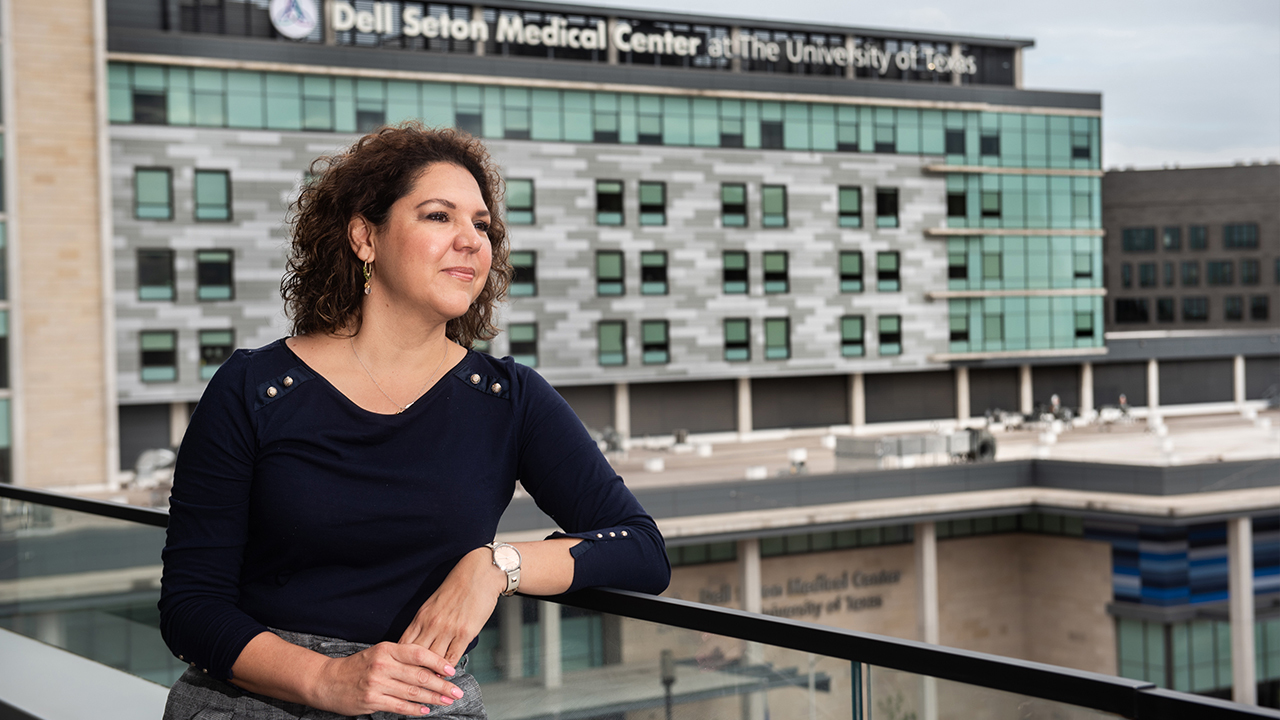 Brenda Garza stands on a balcony overlooking Dell Seton Medical Center.
