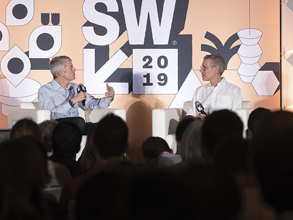 Clay Johnston and David Feinberg speaking on a SXSW panel.