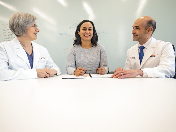 Physicians sitting around a table.