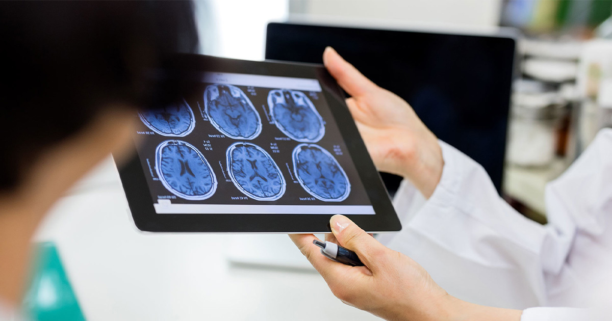 Doctor showing brain scans to patient