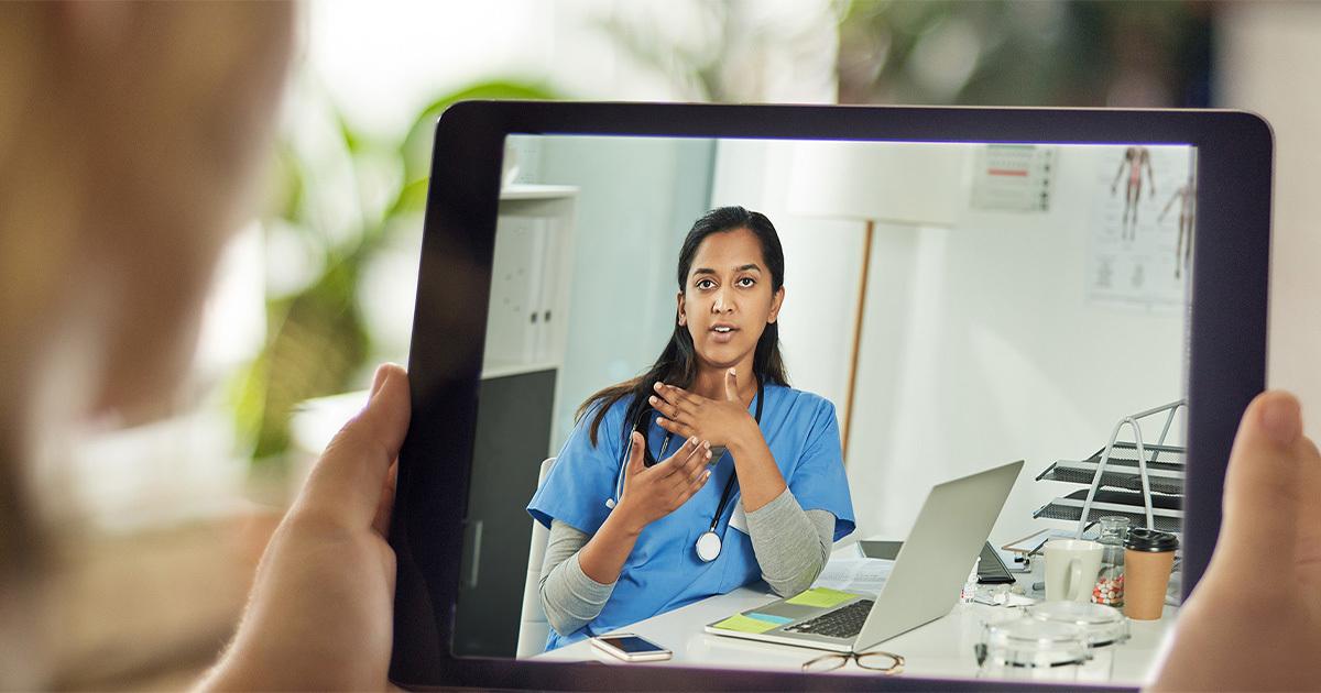 Woman talking to female medical provider via telemedicine