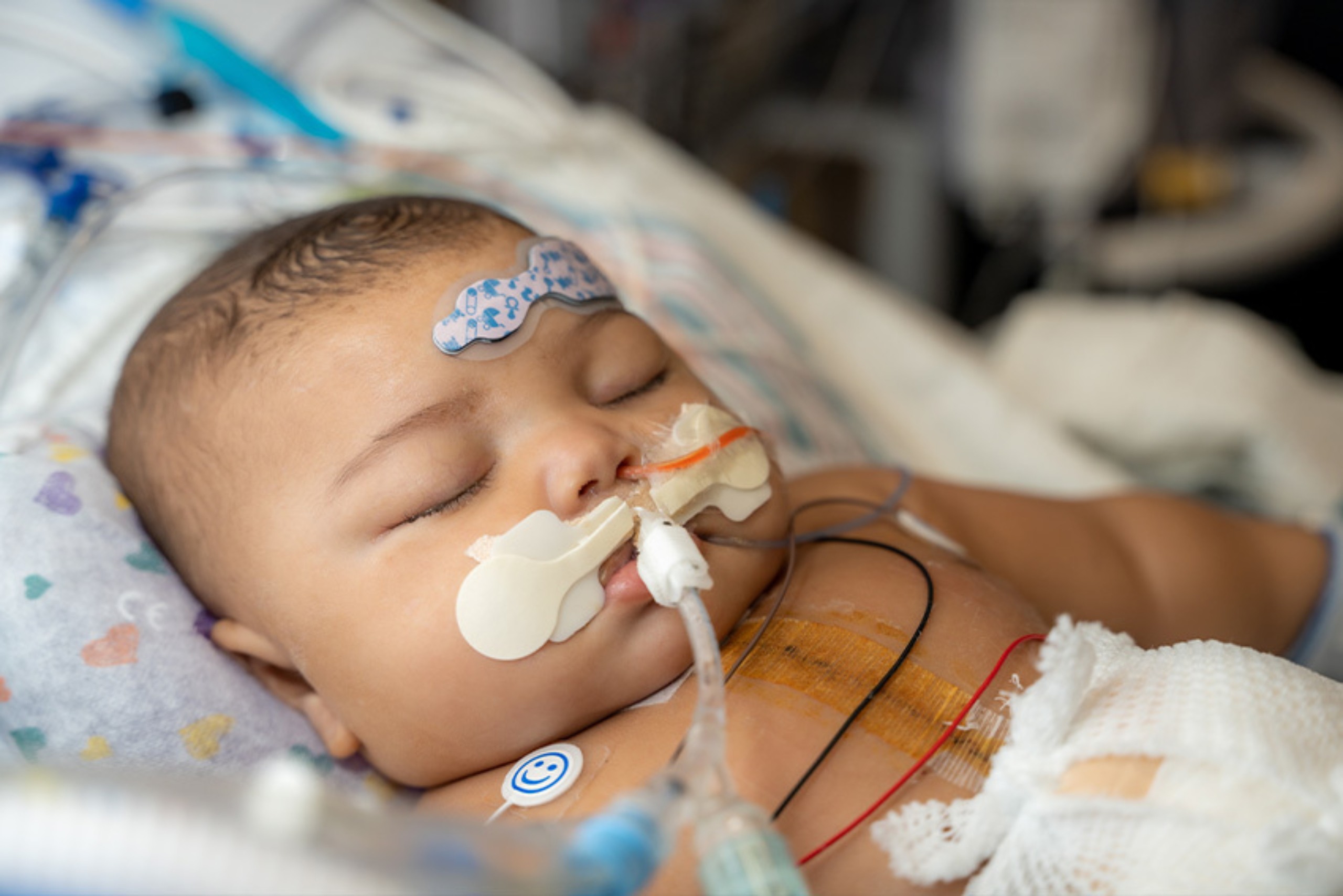 Baby in recovery hooked to machines
