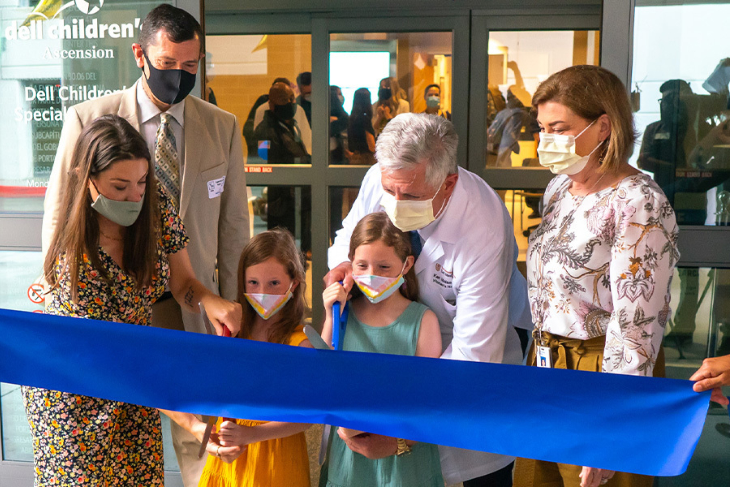 Dr. Kenneth Moise, Jr. is joined by former patient Amber Cessac and her twin daughters, Noelle and Edwin, to cut the ribbon at the opening ceremony for theComprehensive Fetal Care Center.