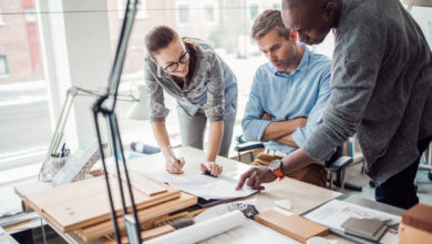 Specification Writer, Architect or Engineer at drafting table