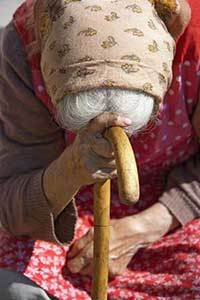 Old Woman leaning on her cane