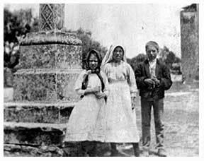 The children standing in front of the parish church in Fatima