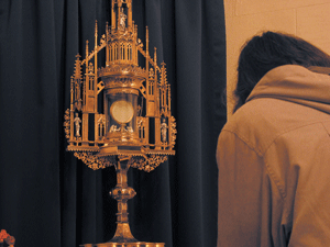 Praying in front of the Blessed Sacrament