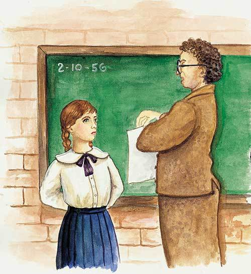 Teacher and student in classroom