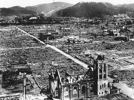 Image: black and white photograph of an aerial view of Hiroshima, with a church in the foreground