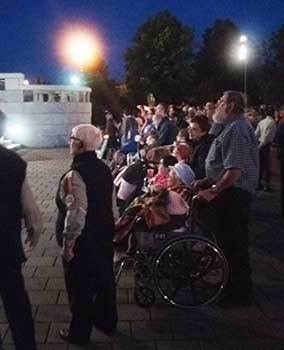 People at the Shrine in wheelchairs praying for healing