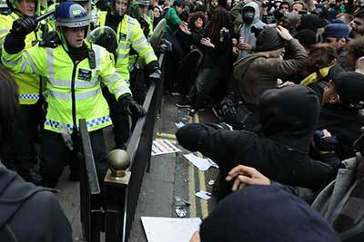 Police holding back a mob of protesters