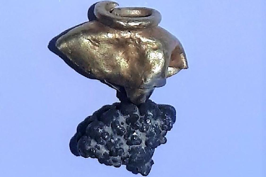 A gold and silver earring uncovered in Jerusalem