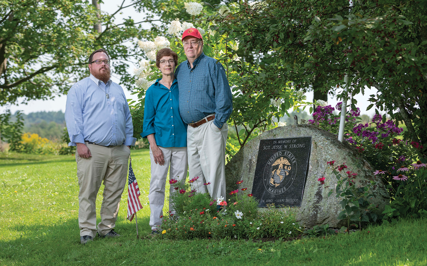 Matthew Strong and his parents, Vicki and Nate, stand next to a memorial at their home dedicated to Matthew's brother Jesse, who was killed in action in 2005.
