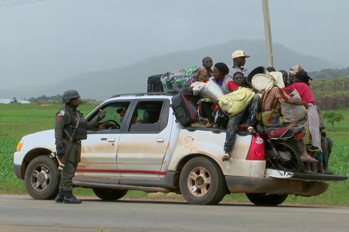 People drive to safety after a 2018 clash between Fulani herdsmen and Christian villagers in Jos, Nigeria.