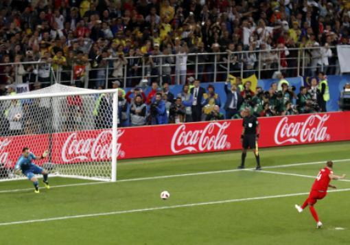 England's Eric Dier scores a penalty shot past Colombia goalkeeper David Ospina during a World Cup match on Tuesday in Moscow.