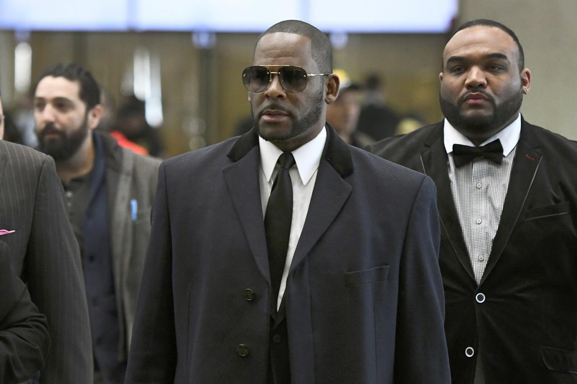 R. Kelly (center) at the Leighton Criminal Court building in Chicago on May 7