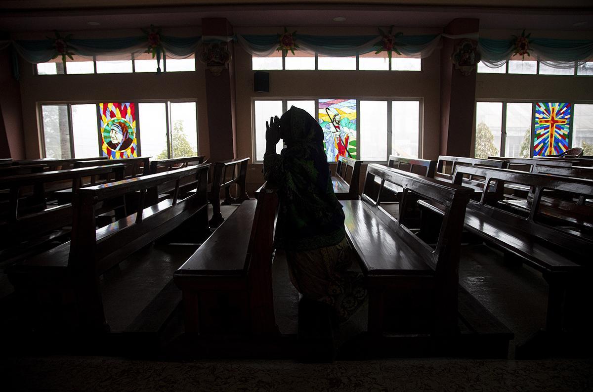 A woman at a church Gauhati, India