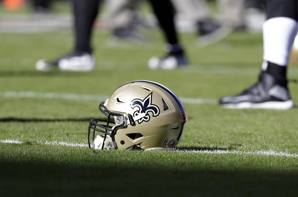 A New Orleans Saints helmet on the field prior to an NFL game in Kansas City