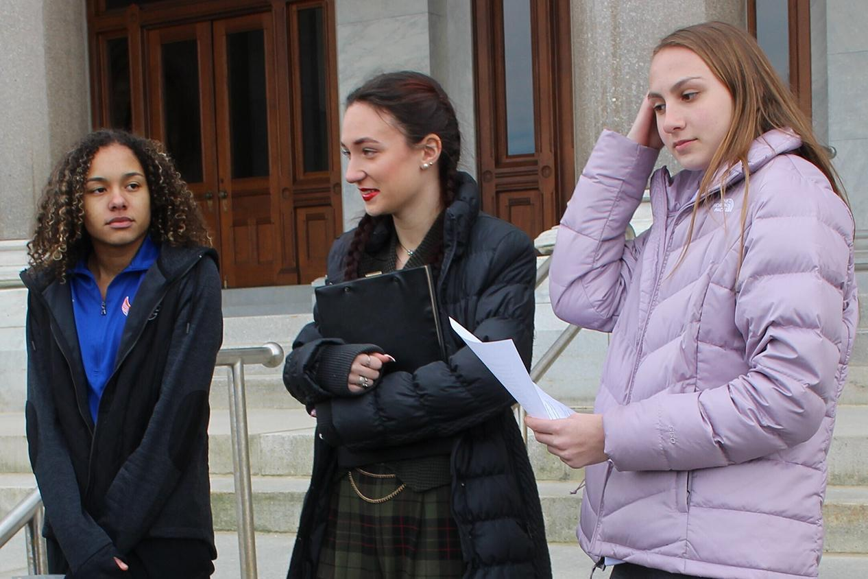 From left: Alanna Smith, Selina Soule, and and Chelsea Mitchell outside the Connecticut State Capitol in Hartford on Wednesday