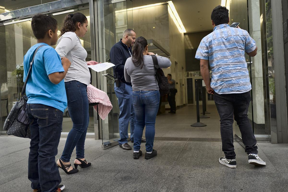People outside an immigration court in Los Angeles in late February