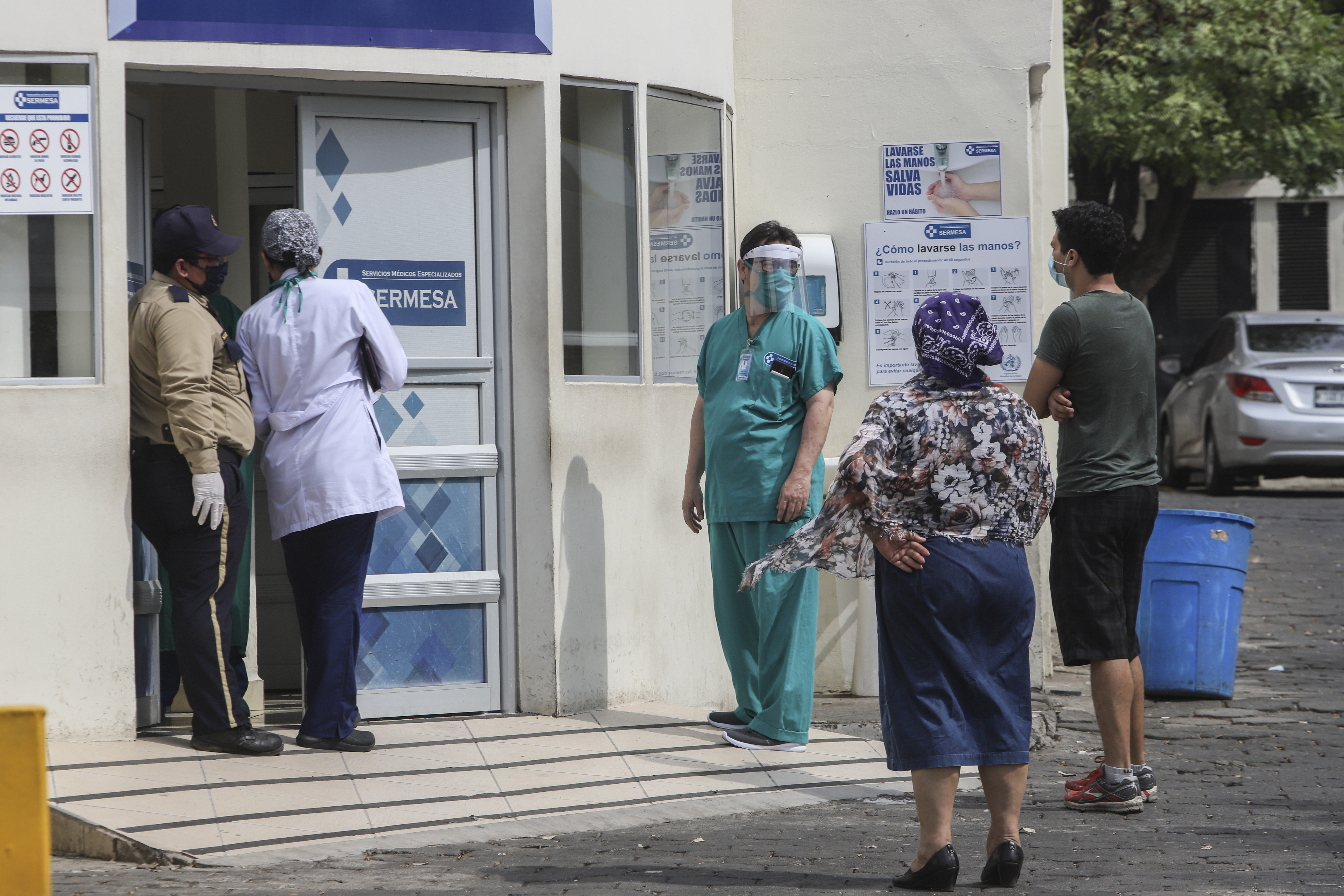 A medical worker at the entrance of the SERMESA hospital in Managua, Nicaragua