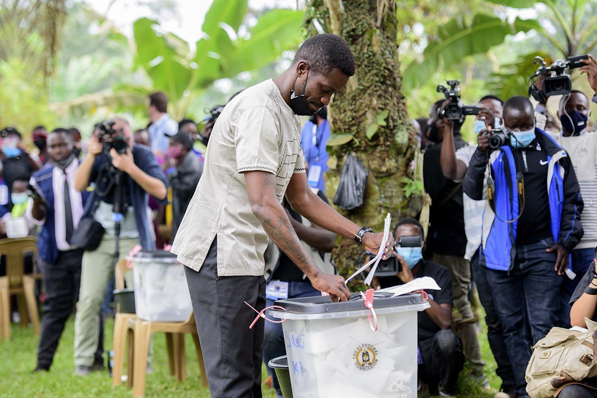 Bobi Wine casts his vote in Kampala, Uganda, on Thursday.