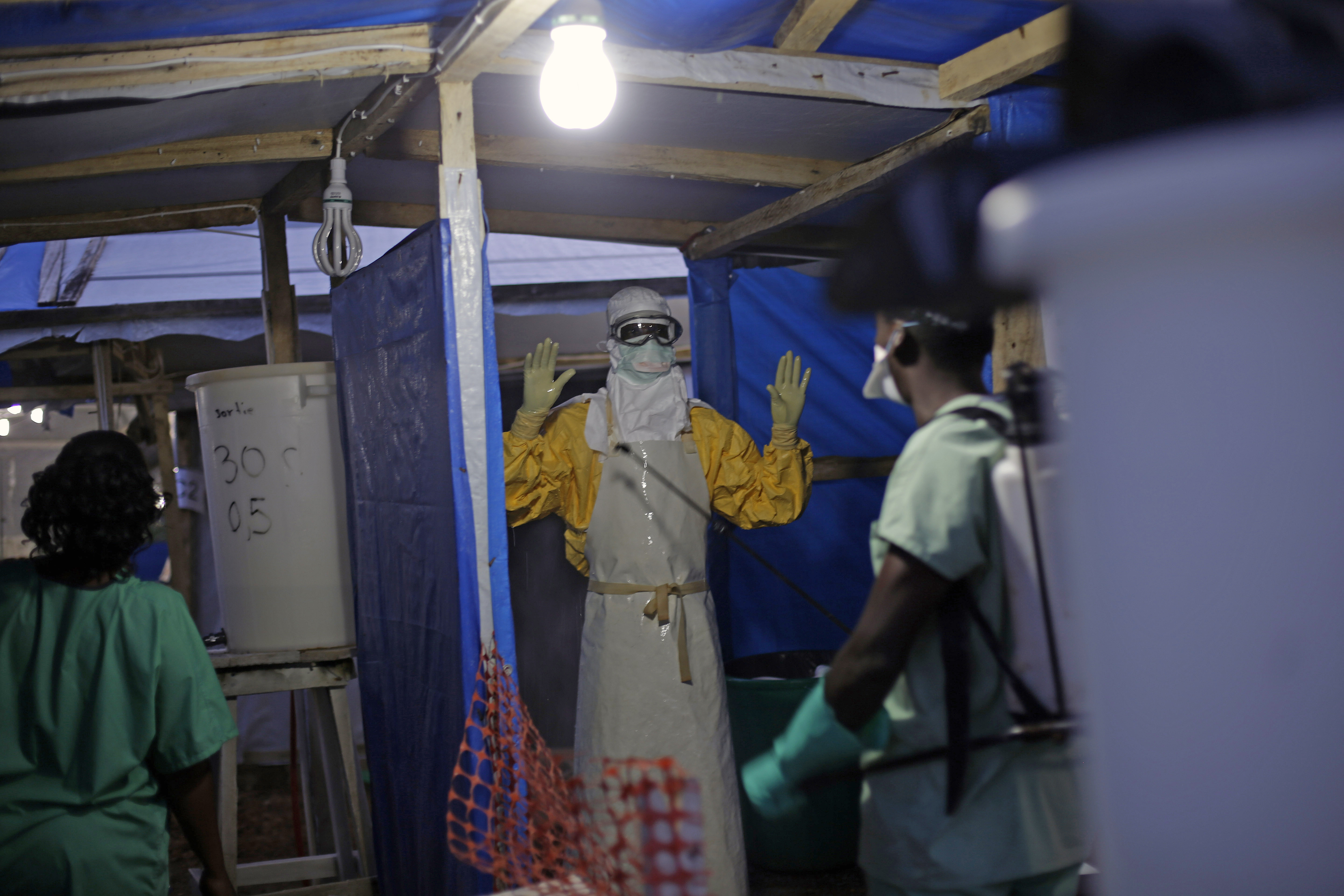 A health worker at an Ebola treatment center in Gueckedou, Guinea