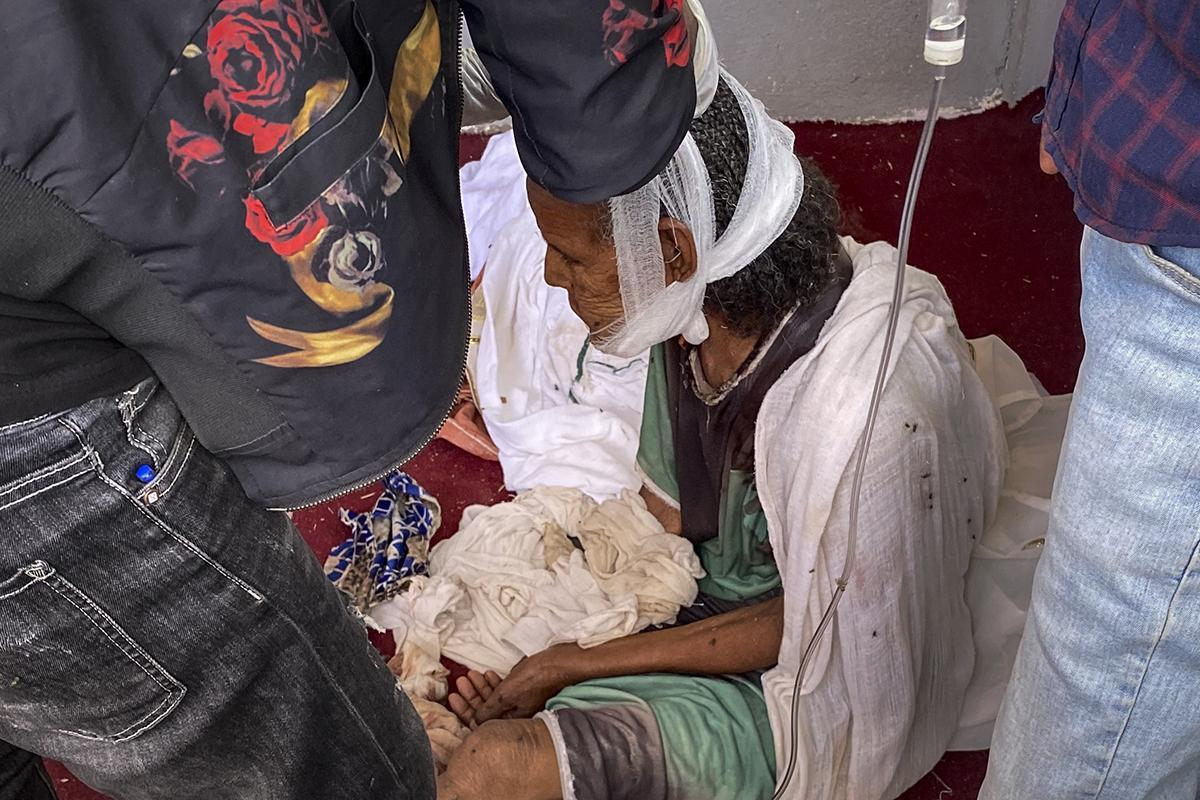 An elderly woman after an attack on the city of Axum, Ethiopia, in November