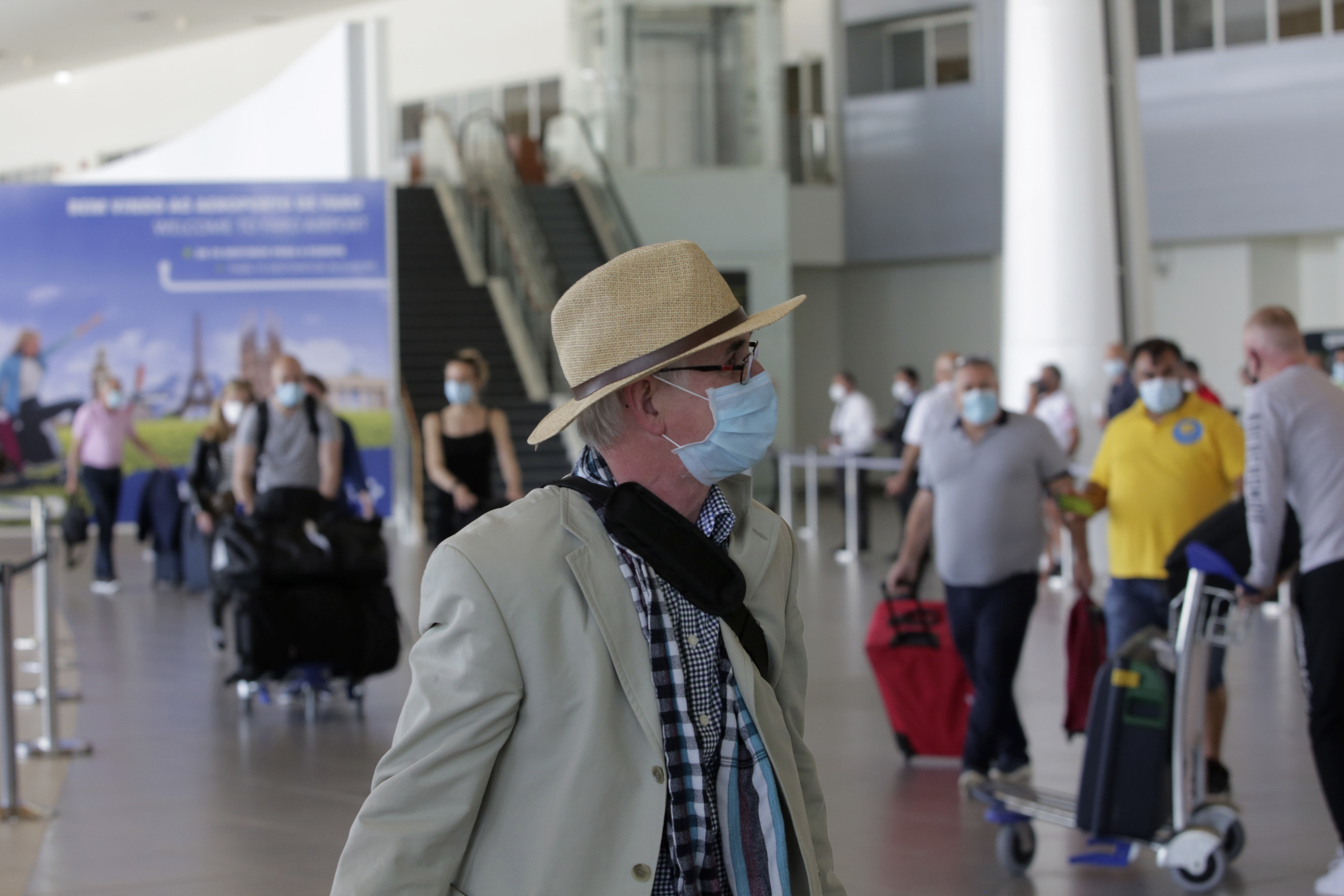 Passengers on a U.K. flight arrive at the airport in Faro, Portugal, on Monday