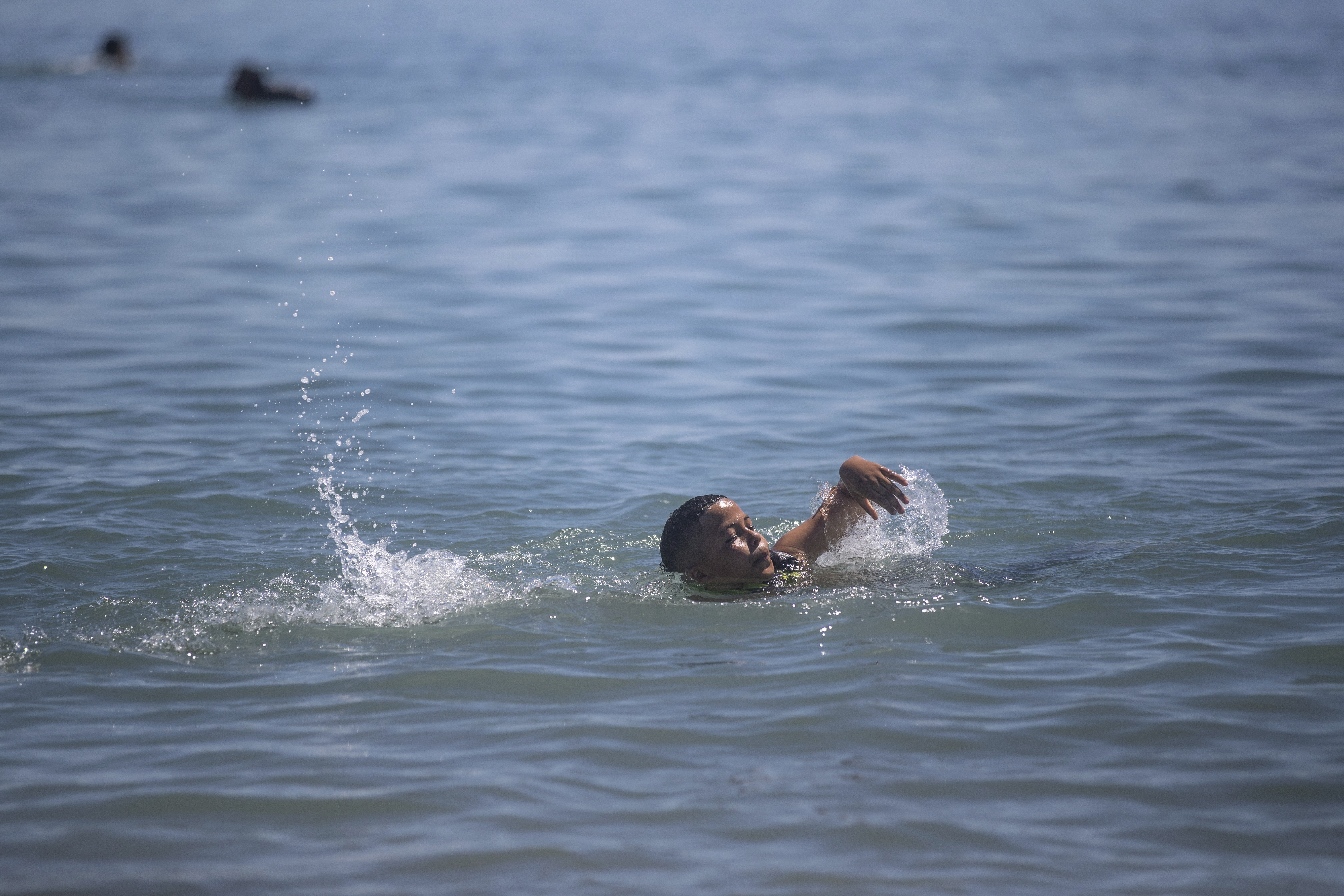 A boy swims from the Moroccan border town of Fnideq toward the Spanish enclave of Ceuta on Wednesday.