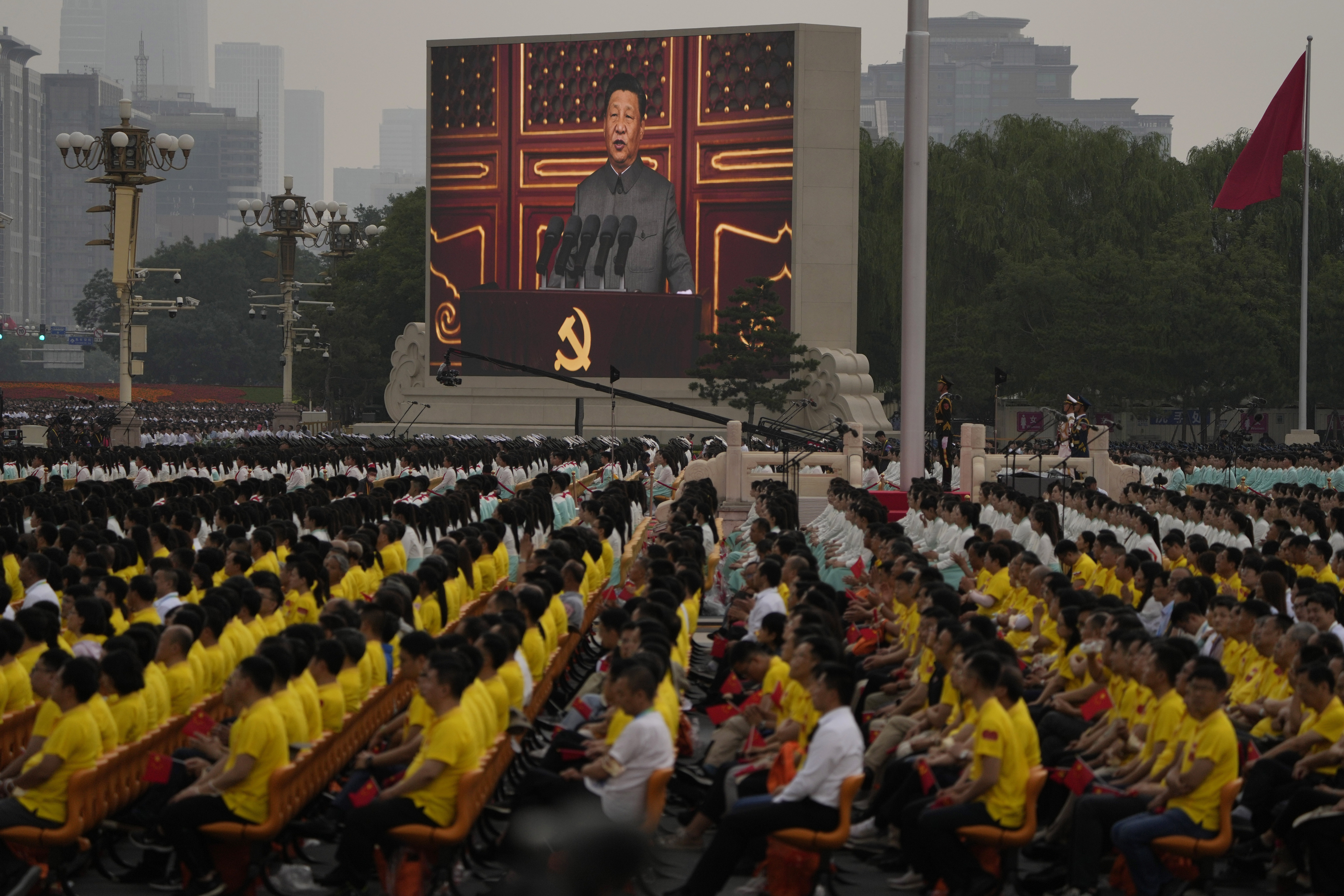 A screen shows Chinese President Xi Jinping speaking during Thursday's ceremony.