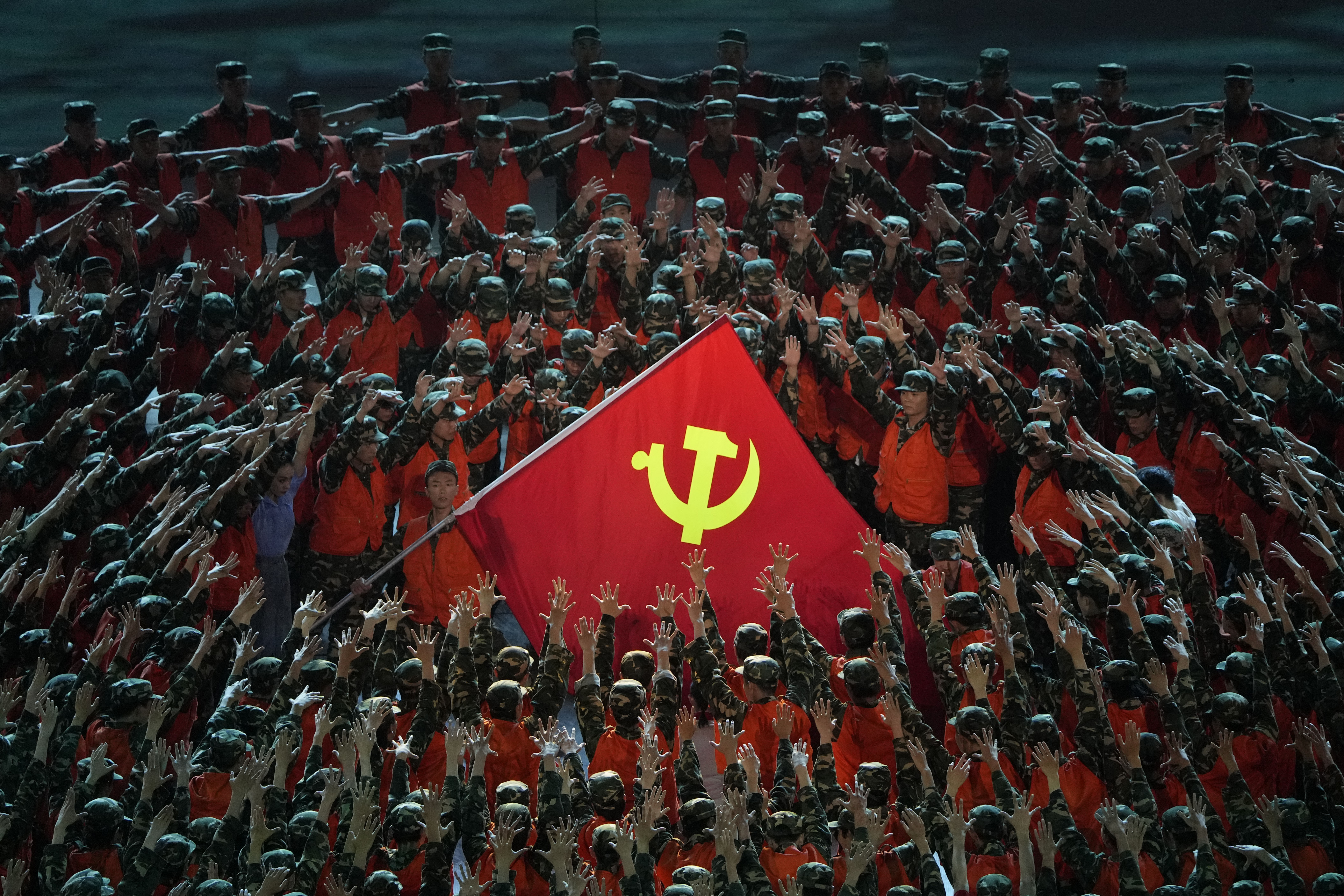Performers during a show ahead of the Chinese Communist Party's 100th anniversary in Beijing Monday