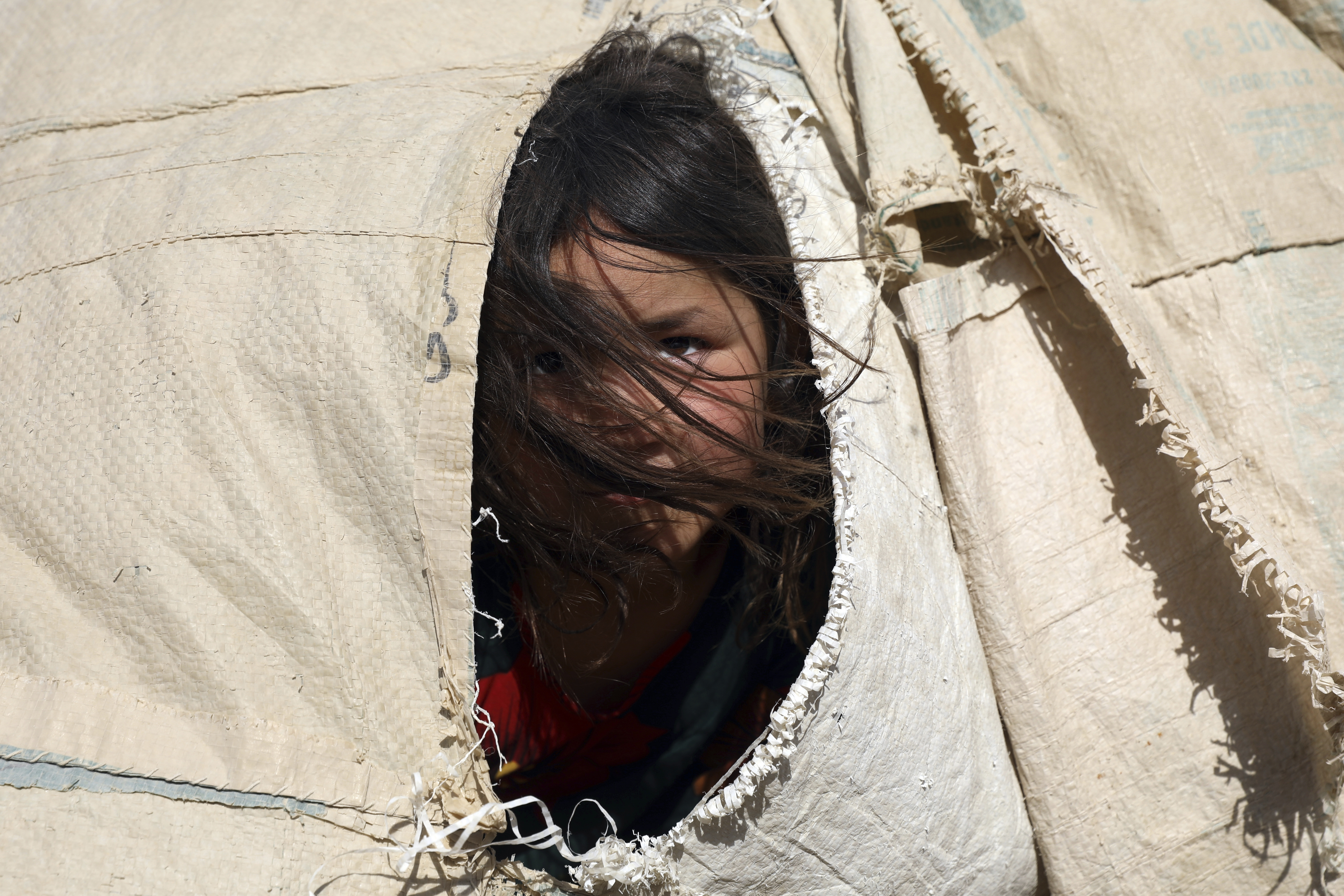 An internally displaced girl in a camp on the outskirts of Mazar-e-Sharif, Afghanistan