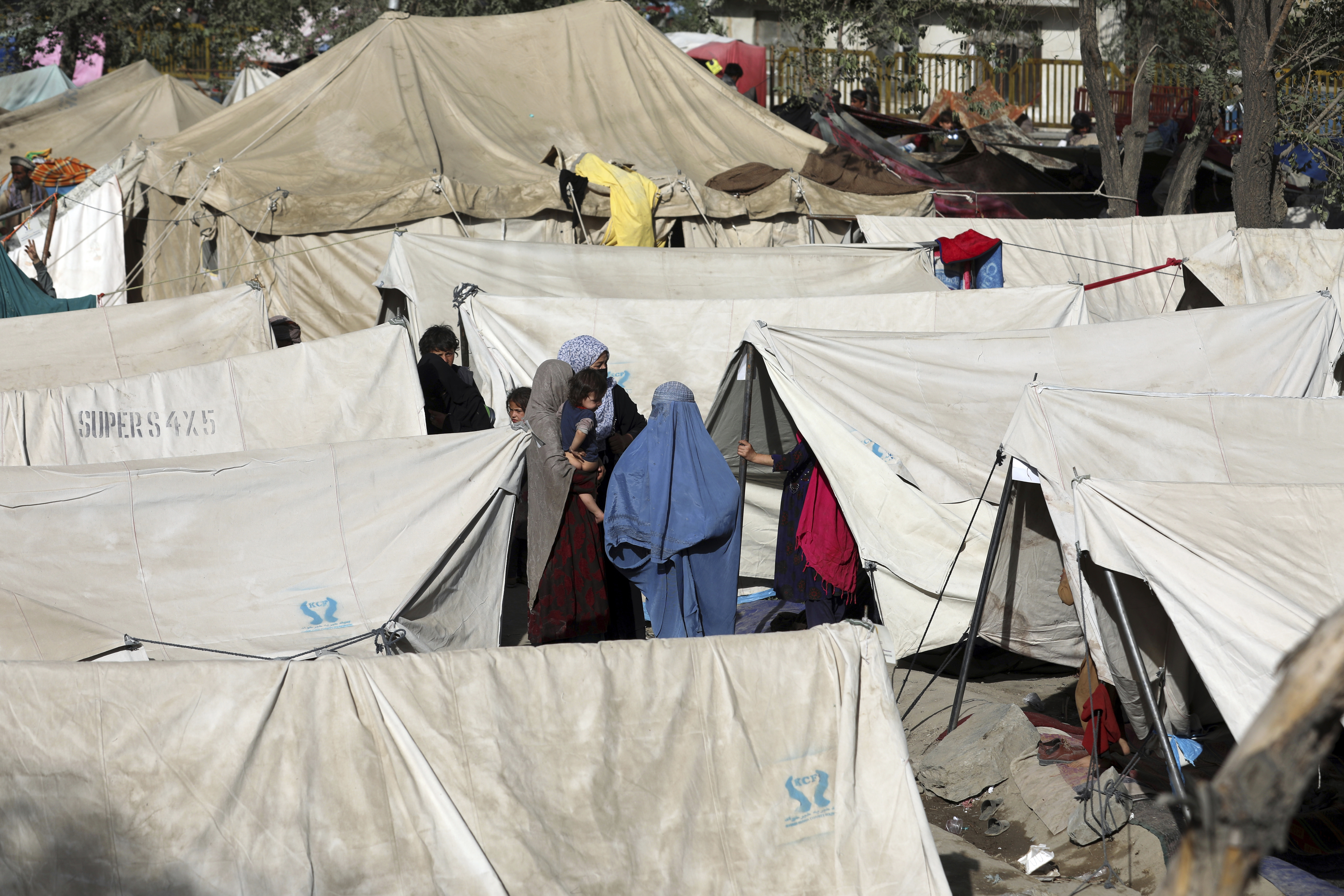 Internally displaced Afghans, fleeing the northern provinces due to fighting between the Taliban and Afghan security forces, take refuge in a public park Kabul on Friday.