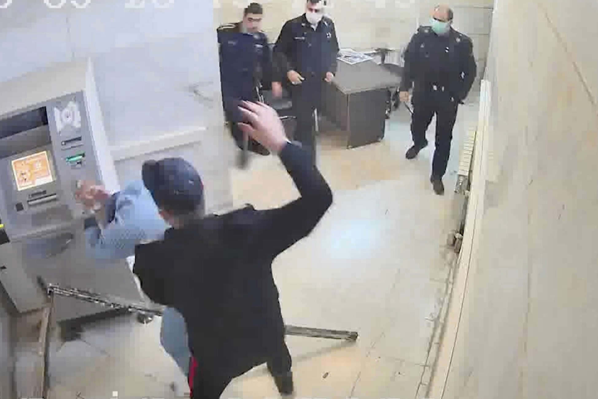 An undated frame grab from a video showing a guard beating a prisoner at Evin prison in Tehran, Iran