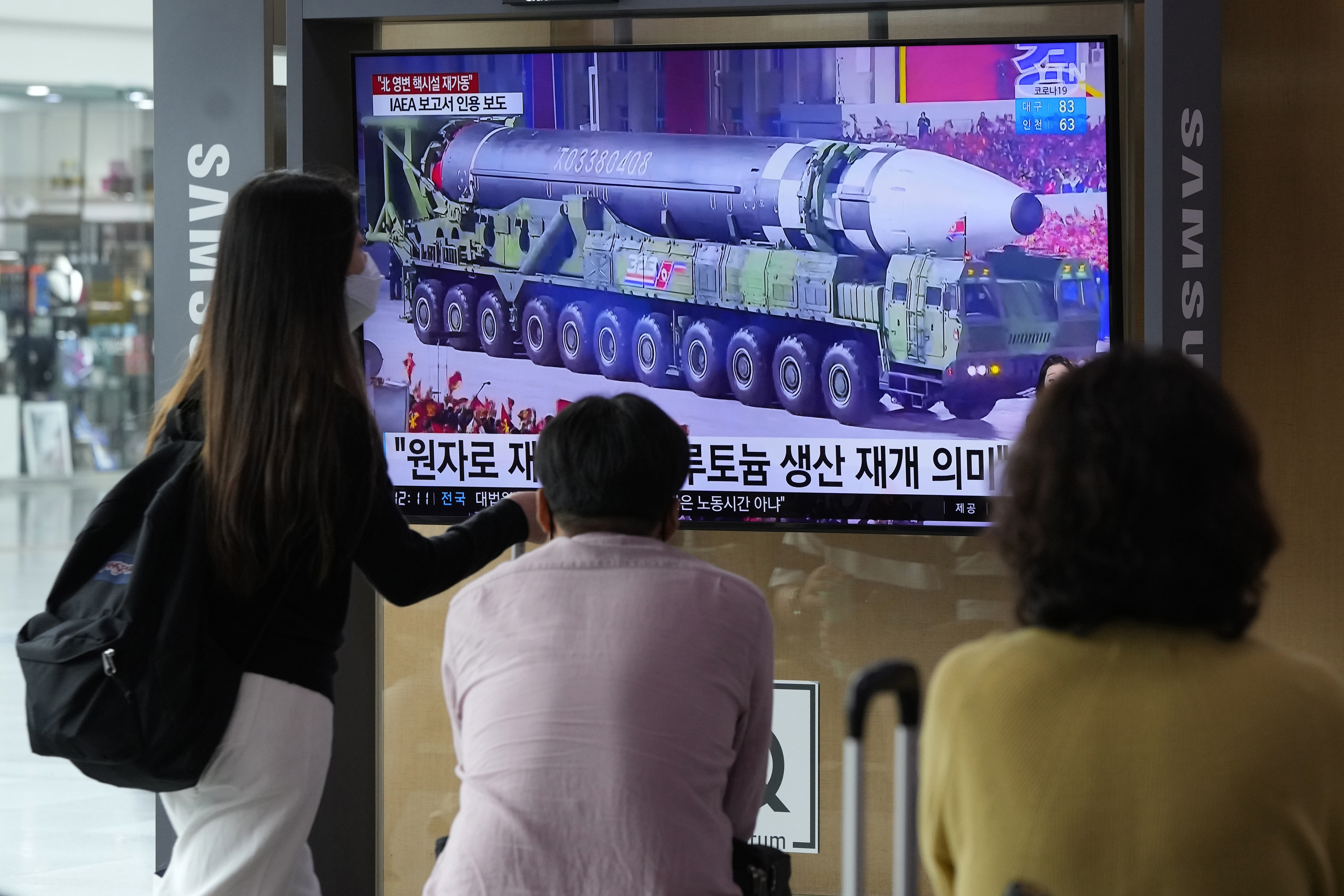 A TV screen in Seoul, South Korea, on Monday shows an image of a North Korean missile in a military parade.