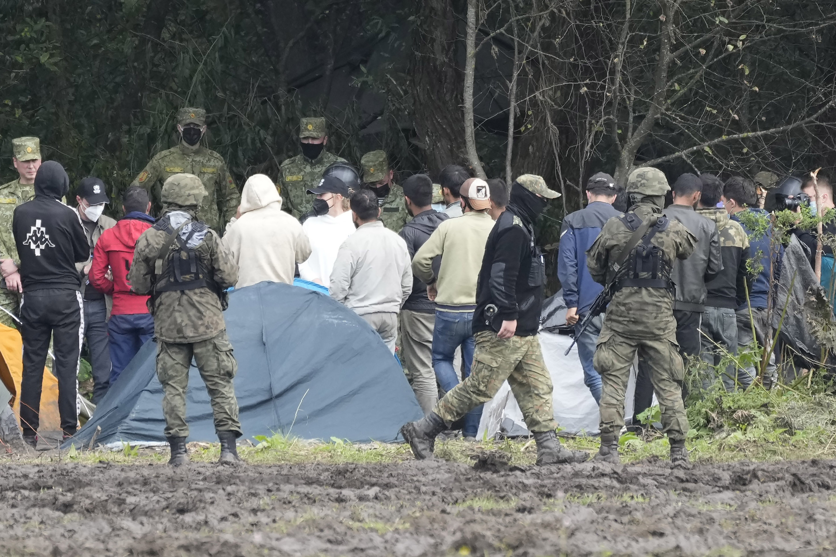 Polish security forces block migrants stuck on the border with Belarus in Usnarz Gorny, Poland.