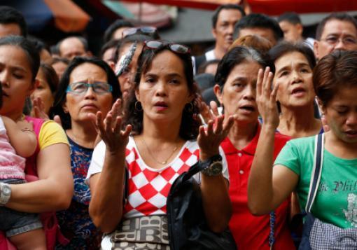Catholics pray at a church in Manila.