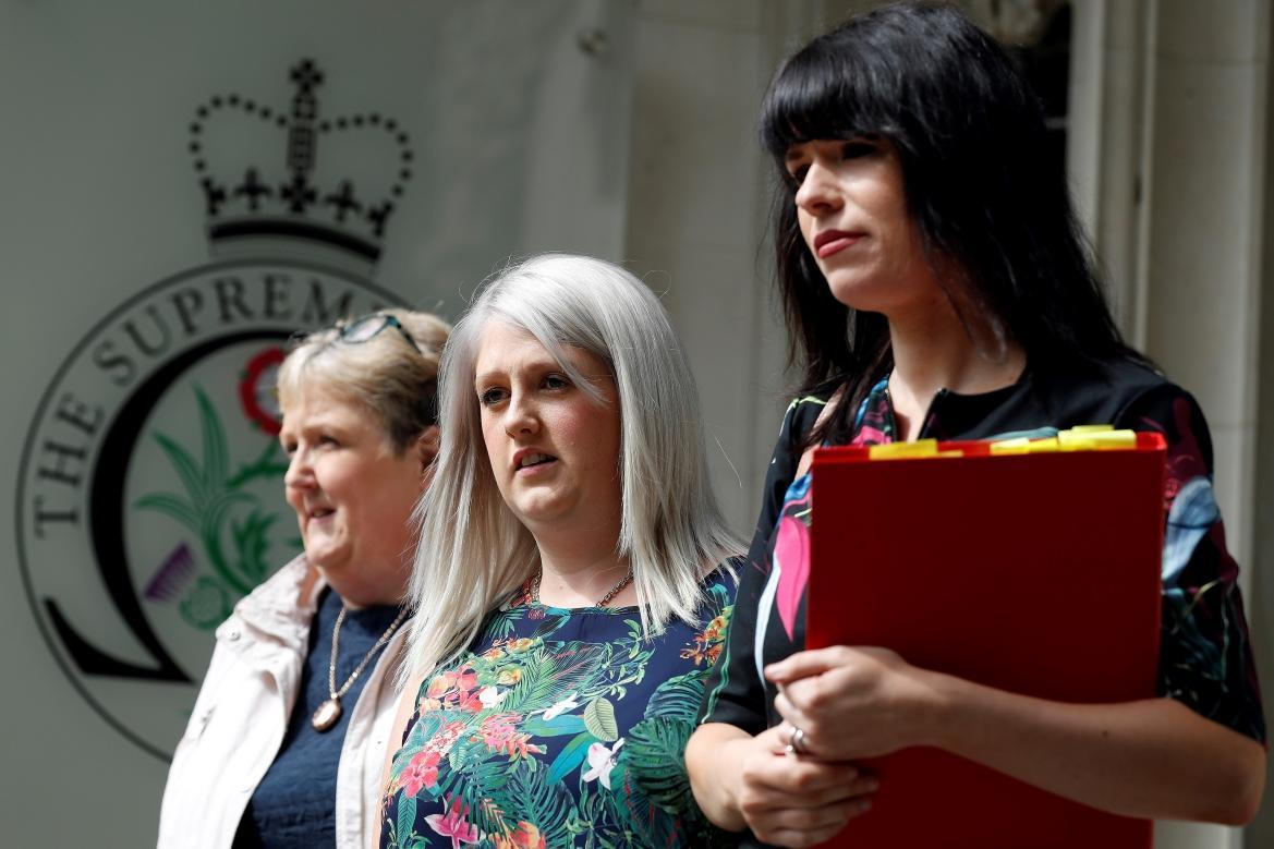 Northern Ireland campaigner for Amnesty International Grainne Teggart (right) and Sarah Ewart (center) at the Supreme Court in London