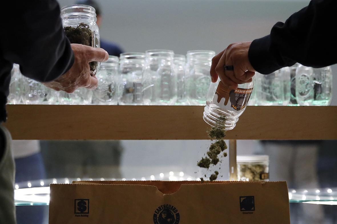 Los Angeles police during a raid at an illegal marijuana dispensary in Compton, Calif.